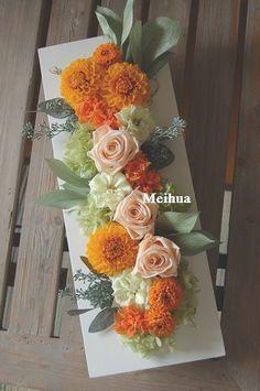 ビタミンカラーの壁掛けプリザーブドフラワー。人気のダリアを細長タイプでアレンジしました。 http://www.meihua-f.com/shop/mpri/pri204.html