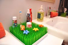 Boon Grass to hold toothbrushes and accessories in the kids' bathroom.  Genius!
