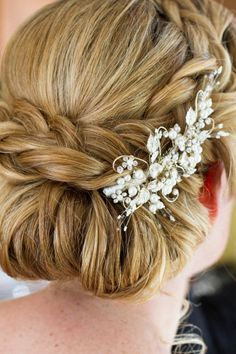 Wedding Hair braided up-do. BKB & CO. is an award-winning wedding photography and cinematography firm located at 213 Newbury Street Boston, Massachusetts. Their work has been featured in countless nationally-published trades including BRIDES, The Knot, Boston Magazine and many more.
