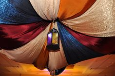wondering how the fabric is attached to the ceiling?? A trip to Home Depot?? Arabian event tent drape | Flickr - Photo Sharing!
