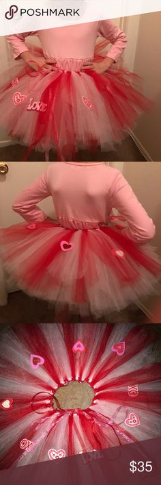 Valentines pink white and red Tutu skirt This tutu has 3 double layers of tulle. It is very full and fluffy. The tulle is 11 inches long from the waist. It has ribbon weaved through it so you can tie it around your little princess waist. My daughter pictured wears a size 7 and it fits her perfectly. I make these myself and can make it in a smaller or larger size. Prices do vary on size. Handmade by A & K Pretties Bottoms Skirts