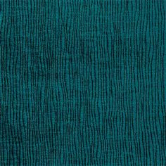 An abstract velvet fabric with slight texture in a deep turquoise blue. This high-performance velvet is suitable for heavy-use furniture such as