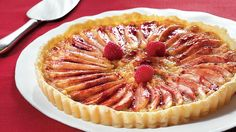 Top raspberries, pears and almonds with Pillsbury® refrigerated pie crust to bake this delicious tart - perfect for dessert.