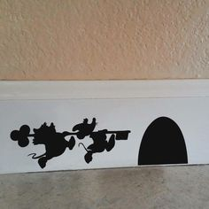 Check out these clever little illusion decals. These Disney Character Mouse Hole decals give the appearance of character shadows running to a mouse hole. These cute Disney Character Mouse Hole decals are made from a matte vinyl, to look like they've been Casa Disney, Disney Diy, Disney Crafts, Disney House, Disney Mural, Disney Wall Decals, Punk Disney, Kids Wall Decals, Vinyl Art