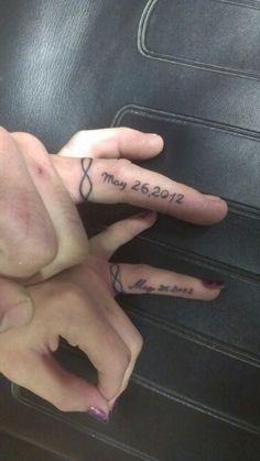 43 Awesome Wedding Ring Tattoos | WeddingomaniaI Don't like the dates, but I like the idea of the band of infinity symbols.