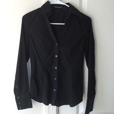 Express Black Fitted Oxford Closet staple. This is the sexiest fitted black Oxford. Comfortable stretch and darts at the bustline and back for a more feminine fit. Express Tops Button Down Shirts