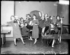 Group portrait of the University of Chicago Jazz Band, entirely composed of women, playing their instruments in a room, Chicago, Illinois, 1926. From the Chicago Daily News negatives collection.