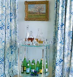 A Lucite bar cart is another take on the traditional-meets-modern theme of the living room.