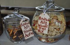 Winnie the Pooh Party Hundred Acre Woods Acorns (chocolate kisses, mini vanilla wafers, butterscotch morsels and melted chocolate to hold it all together) and Hundred Acre Woods Trail mix (Honeycomb cereal, honey roasted peanuts, honey Teddy Grams, and M&Ms.)