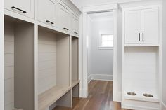 Simple, minimalistic white mudroom template includes built in pet food bowls with shiplap trim.