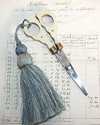 I'm going to put a tassel on my little stork scissors.