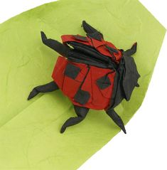 Ladybug - Marc Kirschenbaum's Sakura Origami Given the subject's near universal appeal (some regard its presence as good luck), this ladybug is showcased on the cover of Origami Bugs. To obtain the specific pattern of dots on the wings, each spot is treated as an actual appendage. sakuraorigami.com