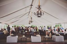 White tent with drape and chandeliers