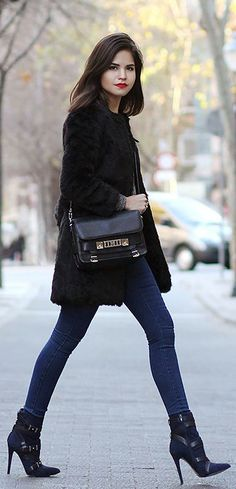 Just The Design: Adriana Gastélum is wearing a black faur fur coat and indigo jeans from Iclothing, boots from Guess and the bag is Proenza Schouler PS11... | Style Inspiration