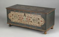 "Pook & Pook.  4/21/07.  Lot 753.  Estimated: $20K - $30K.  Realized: $46,800.  Lancaster County, PA. Painted dower chest dated 1795 by the Embroidery artist, the lid with typical sawtooth border panel surrounded by florettes over a case with a large ivory panel decorated with tulip vines, pomegranates, etc., inscribed ""Catharina Mauren"", supported by bun feet, 22 3/4"" h., 50"" w. Illustrated in Fabian The Pennsylvania-German Decorated Chest fig. 223."