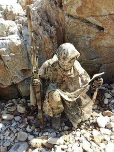 Sniper... Now that is incredible  camouflage: