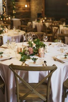 The vision for this copper and blush inspiration shoot was simple: we wanted a bright, romantic look that felt elegant, warm, and natural. We used copper pipes and tubing in unique design elements that added to the charm. For the centerpieces we cut lengths of copper refrigerator tubing to create these hoops that the florist incorporated into her arrangements.