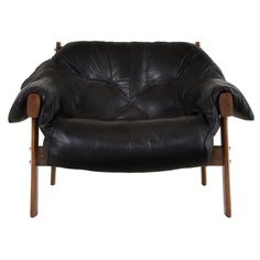 A cooler black lounge chair | Percival Lafer Lounge Chair in Black Leather | From a unique collection of antique and modern lounge chairs at http://www.1stdibs.com/furniture/seating/lounge-chairs/