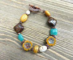 Stone, lamp work and Czech glass flowers and copper metal bracelet. Teal, mustard yellow, brown and cream jewelry. - - McKee Jewelry Designs - 1