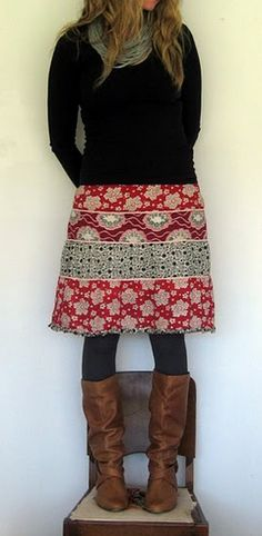 Like the skirt and gray tights with brown boots