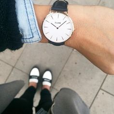 The Cluse La Bohème model features an ultrathin case with a 38mm diameter, crafted with precision for a sophisticated and elegant result. Eggshell white and silver are combined with a black leather st