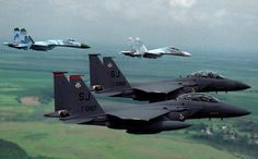 """2 US Air Force McDonnell-Douglas Strike Eagles being escorted by a Ukrainian Air Force Sukhoi """"Flanker"""", with another """"Flanker-B"""" leading the way Military Jets, Military Weapons, Military Aircraft, Fighter Pilot, Fighter Aircraft, Fighter Jets, Airplane Fighter, Armada, Aircraft Pictures"""