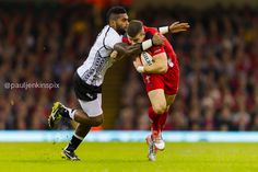 Scott Williams takes one on the chin during the Fiji game.