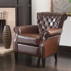 Tradition and elegance pair together in this overstuffed Christopher Knight leather club chair. Upholstered in bonded leather, this tufted club chair adds an element of classic sophistication to your
