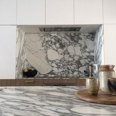 Bougainvillea Row House by Luigi Rosselli Architects - Kitchen  Luigi Rosselli Architects | Bougainvillea Row House | Carrara #marble with a shark nose edge is an everyday reminder of the melting pack ice at the Earth's poles. The pleasure of working in a compact #terracehouse is that the space restrictions in the kitchen discourage the inclusion of extra-large or multiple ovens, and the oversized fridges full of spoiling food. | © Sean Johnson | #LuigiRosselliArchitects