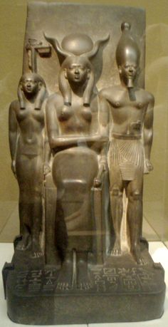 A triad statue depicting the Hare Nome goddess, the goddes Hathor, and the pharaoh Mekaura. Originally from the Valley Temple of Mycerinus at Giza, made of Greywacke. Created during the 4th dynasty, circa 2548-2530 B.C. Now at the Museum of Fine Arts, Boston........photo by Keith Schengili-Roberts.............SOURCE WIKIPEDIA.ORG...........