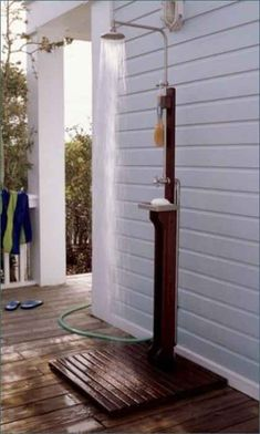 This simple outdoor shower is perfect for a beach house.
