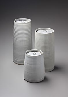 RUPERT SPIRA Three lidded jars, c, 2000 Stoneware, 'Chun' blue glaze, of tapering cylindrical form. Largest: 52.1 cm (20 1/2 in) high Impressed with 'RS' seals (3).