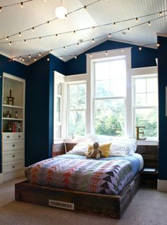 love the lights and rustic bed for a boy's room