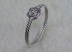 Hey, I found this really awesome Etsy listing at http://www.etsy.com/listing/91068476/mini-twisty-celtic-double-love-knot-ring
