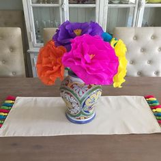 "These Mexican Handmade tissue flowers will add a splash of color to any event! Great for a Cinco de Mayo celebration or a Fiesta Party. You will receive a combination of assorted colors. and add a fun and bright centerpiece to your decor. Price is for 1 flower.  8"" wide each flower Handmade in Mexico"