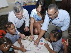 'Do Good' Seeks Basic Learning Tools.  In photo - From left: Chairman of Continental Baking Company Limited, Gary 'Butch' Hendrickson; Miss Jamaica World 2011 Danielle Crosskill and managing director of the Gleaner Company, Christopher Barnes, assist children from The Voluntary Organisation For The Upliftment Of Children in colouring their books. - Colin Hamilton/Freelance Photographer