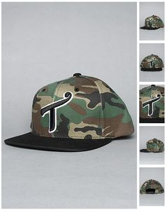 Brand: T.I.T.S (Two In The Shirt). Title: The Classic Snapback Cap in Camo. Purchase it here: http://www.karmaloop.com/product/The-Classic-Snapback-Cap-in-Camo/242998