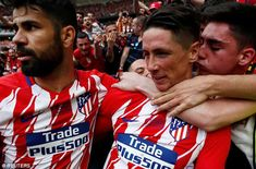 Fernando Torres scored twice in his farewell match for Atletico Madrid as they drew with E...