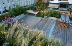 Roof garden in Holland Park By London garden designer Charlotte Rowe. This unusual house in Holland Park has a good sized roof for which there was permission for use as a roof terrace. The roof has wonderful views over the surrounding area and is open to the South.