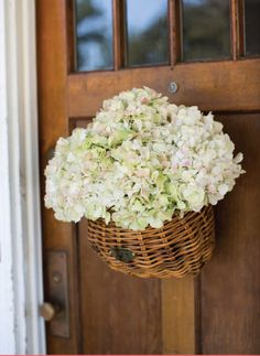 basket full of flowers for the door