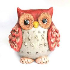 Give a hoot about savings with an owl coin bank.