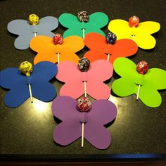 Homemade Butterfly Valentines out of craft foam, tootsie pops and google eyes.