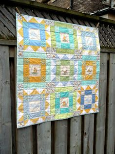 quilt -- classic pooh but more muted colors not florescent