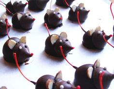 Chocolate dipped Marachino cherry, with a Hershey kiss for head!