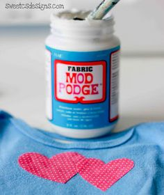 fabric mod podge..who knew, perfect for making t-shirts for girls who are picky about any xtra embellishments on shirts!  this can be something i can even do WITH them!!!