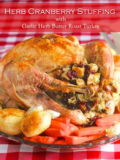 A simple herb and cranberry stuffing in a deliciously juicy roasted garlic & herb butter roast turkey. This will become your go-to recipe for the Holidays.