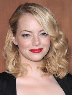 """Shoulder-length: Emma Stone:Emma nails the Mad Men look here, and you can too. Just create a deep side part, then curl hair with a 1"""" curling iron from the ears down, spritzing each section with a heat-protecting spray first. Allow hair to set for at least five minutes before gently brushing out."""