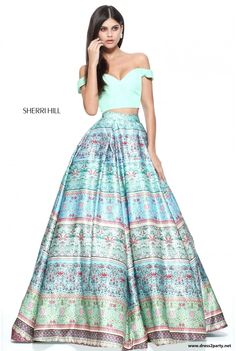 Sherri Hill 51204 a stunning satin two piece. Featuring a beautiful bardot crop top with a plunged sweet heart neckline in turquoise with a full satin printed ball gown skirt. An outfit fit for a princess.