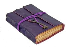 Either write something worth reading or do something worth writing. ~ Ben Franklin.  Purple Leather Journal with Antique Skeleton.