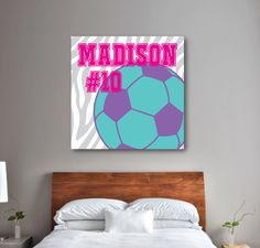Our personalized zebra print canvas with a soccer ball, monogram and jersey number will look great in your bedroom or dorm room.  You can customize it with any colors from our palette or order it in the hot pink, purple, white and pool color combo shown. This custom wall art is the perfect room decor for any girl or teen who loves to play soccer. Great kids sports themed Christmas present or birthday gift for athletes.
